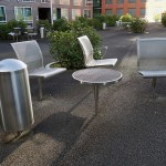 a grey litter bin matching a resting area with chairs and a table in Veldhoven Flight Forum the Netherlands