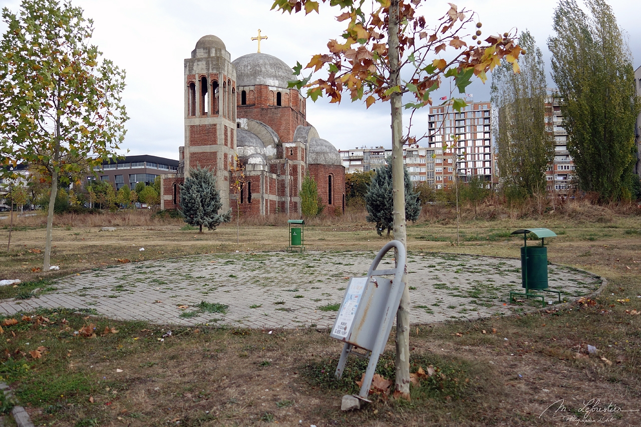 some litter bins in front of Christ the Saviour church, unfinished serbian orthodox church in Pristina Kosovo