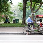 a street litter bin with another green bin in the background of a scene in Hanoi Vietnam