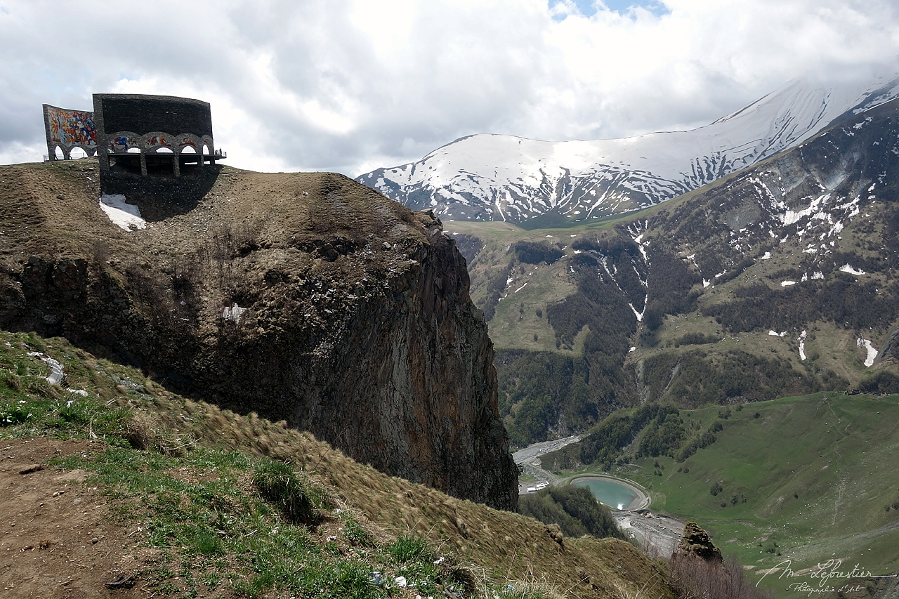 Russia Georgia Friendship monument overlooking the Devil's valley in the Caucasus mountain, seen from the Georgian Military Highway