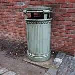 a green litter in in a corner of a street in Prague in the Czech Republic