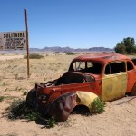 old yellow and red car, abandoned and rusted in the SOLITAIRE gas station in the middle of the desert in Namibia
