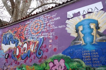details of paintings and graffitis on the John lennon wall in Prague / Praha