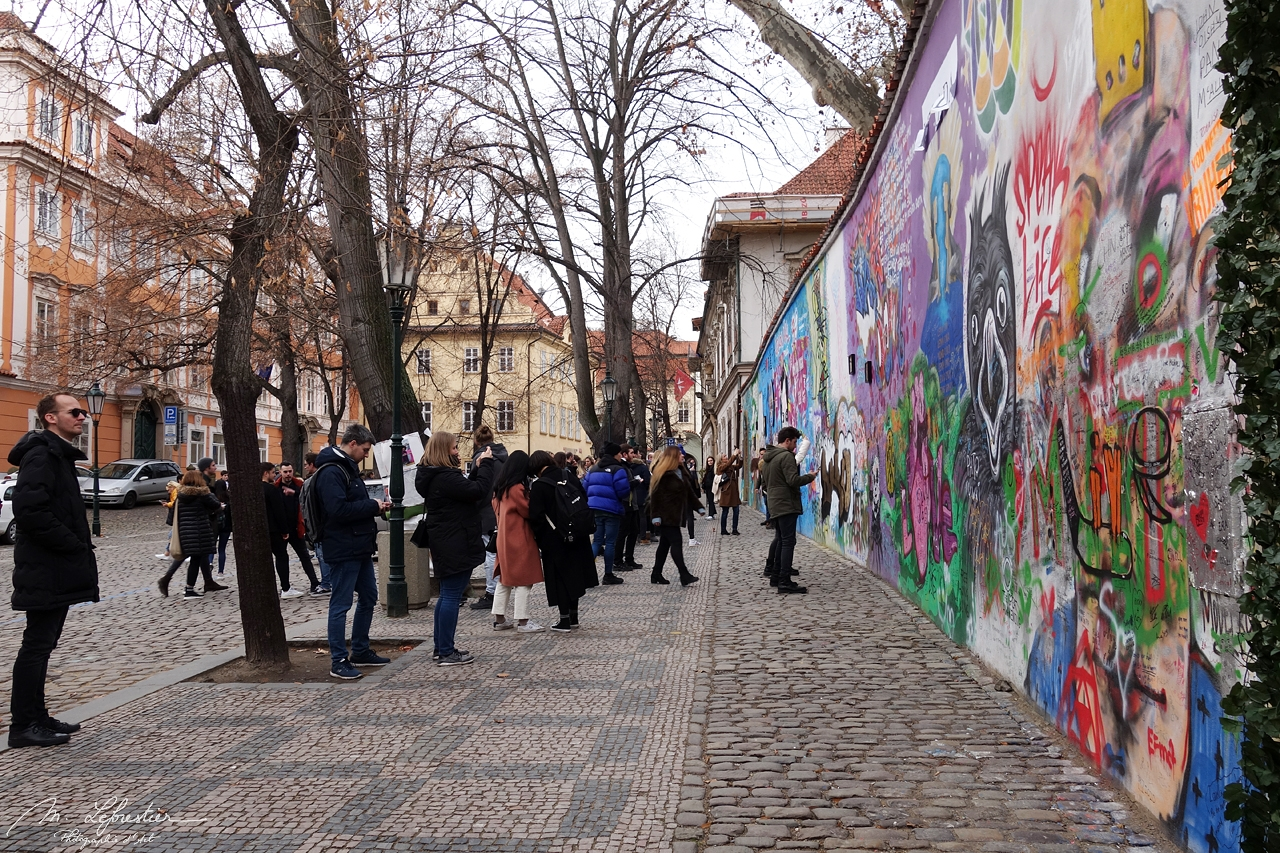 tourists looking at the John Lennon wall representing freedom in Prague Czech republic