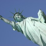 a close up of the statue in Liberty on Ellis island New York