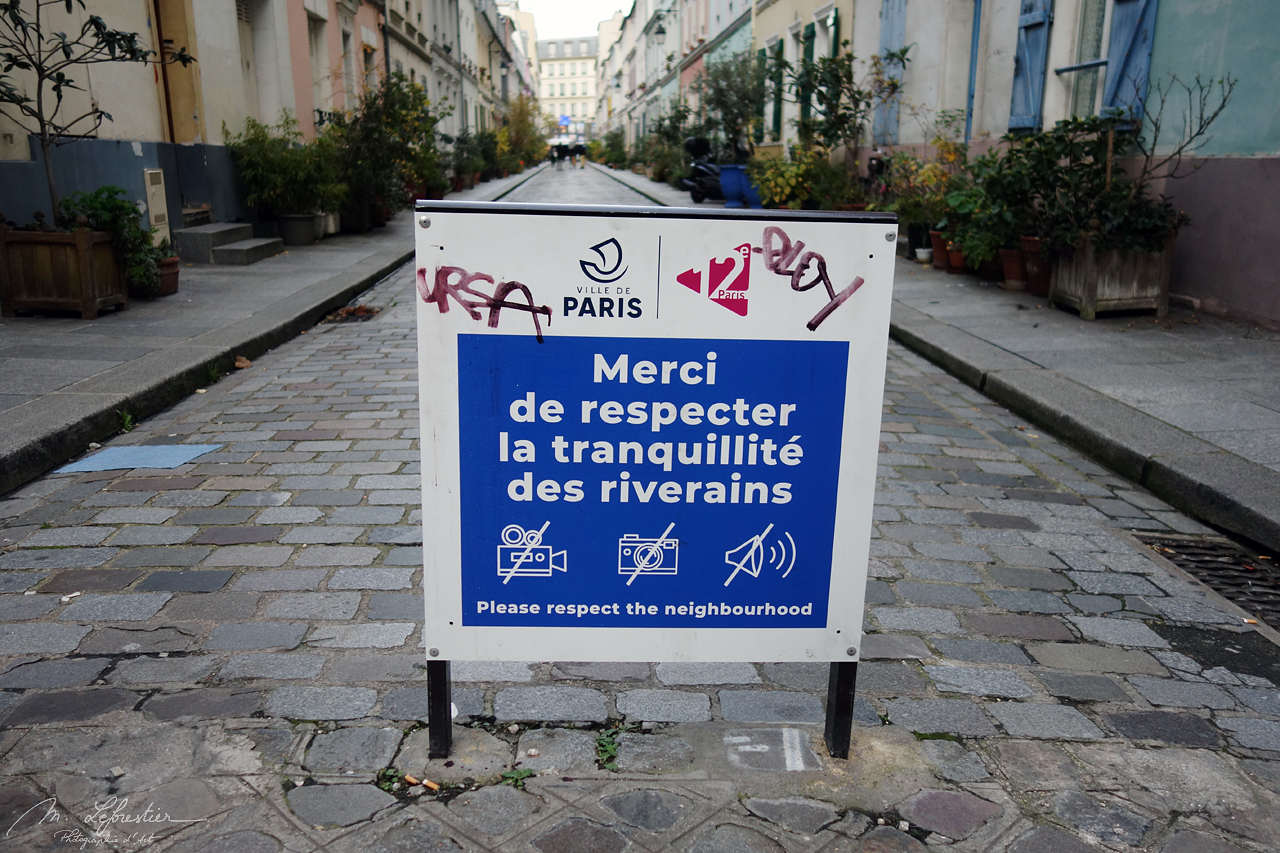 a sign at the entrance of the Rue Cremieux in Paris asking visitors to respect the neighbourhood