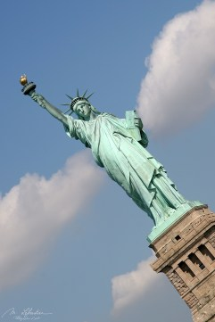 the green statue of liberty on Ellis Island in new york city