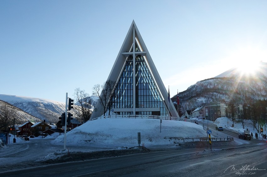 view of the Arctic Cathedral in Tromso on a very snowy day, it is a parish church.