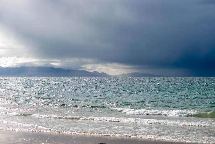 Dramatic skies over the Isle of Eigg viewed from Camusdarach Beach, Scottish Highlands