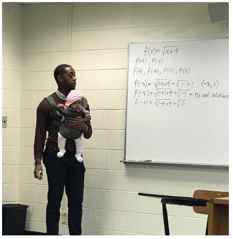 Lecturer Helps Student Carry His Child in Class So He Can Concentrate, Photo Goes Viral
