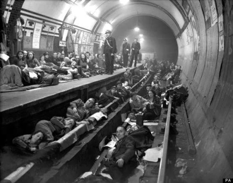 Londoners sleep on the platform and on the train tracks at Aldwych Underground station,London, during heavy all night Nazi bombing raids.