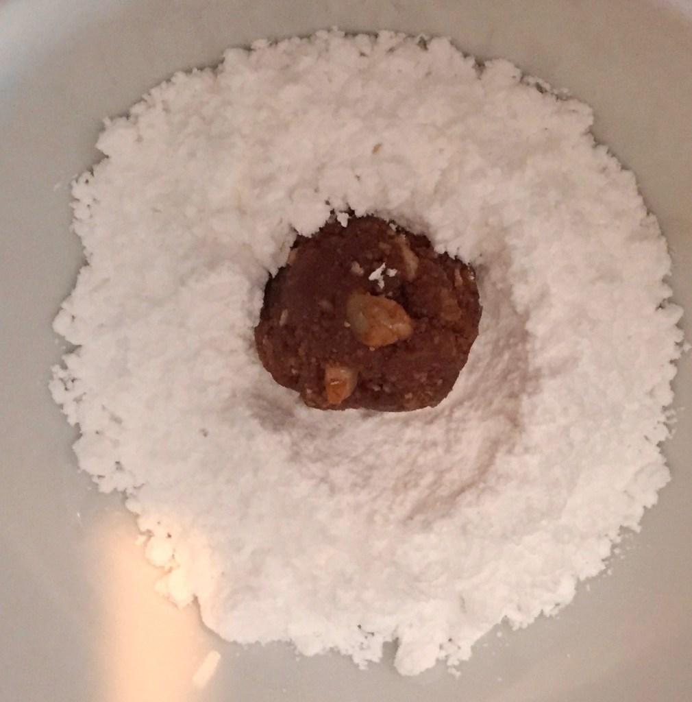 Roll Fireball Balls in powdered sugar