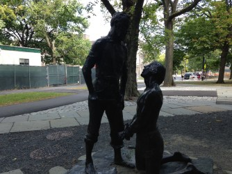 Statue of a father holding a knife to his son for not giving him weekly calls