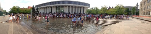 Students in preppy pastel clothing by the Woodrow Wilson Fountain
