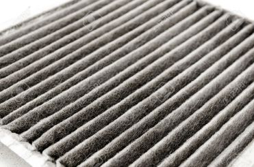 15701578-an-old-dirty-air-filter-for-cars-Stock-Photo