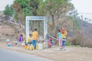 People filling water