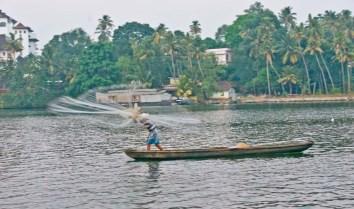 Fisherman with net in the Kerala Backwaters