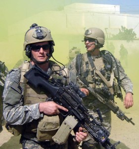 This photo provided by the U.S. Navy shows Navy SEAL Michael A. Monsoor, left, on patrol in Iraq in 2006. Monsoor died Friday, Sept. 29, 2006, in Ramadi, Iraq, when he threw himself on a grenade to save fellow SEALs. (AP Photo/U.S. Navy) ORG XMIT: LA102