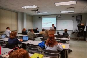 Katherine Smart, of WaveFront Tiller Clutch, presenting the results of her project to develop a plan to market Tiller Clutch through social media.