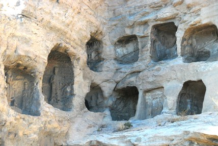 Holes in the wall - each one houses a buddha likeness.