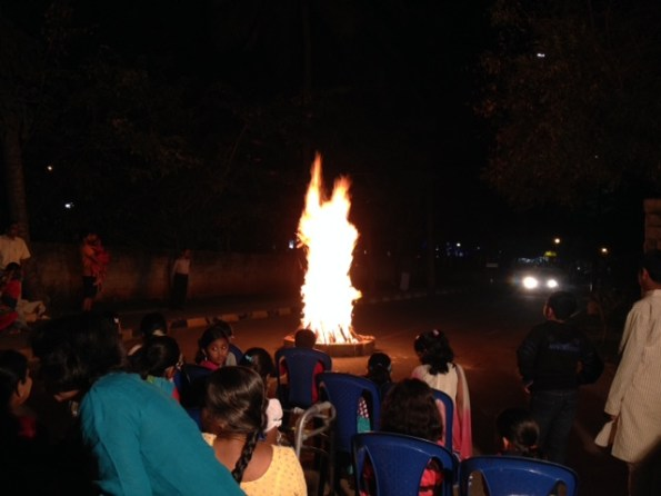 People initiating the rituals by circling the fire as the festivities begin