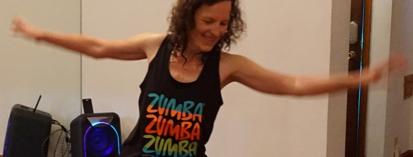 Marie Kube dancing in a Zumba® tank top and Air Bounce high top shoes.