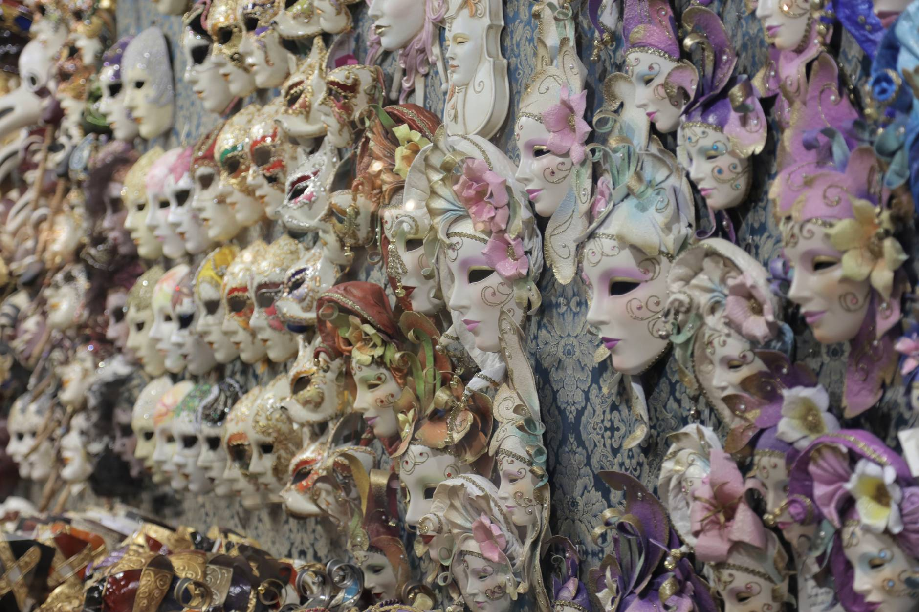graceful handicraft masks for carnival hanging on wall