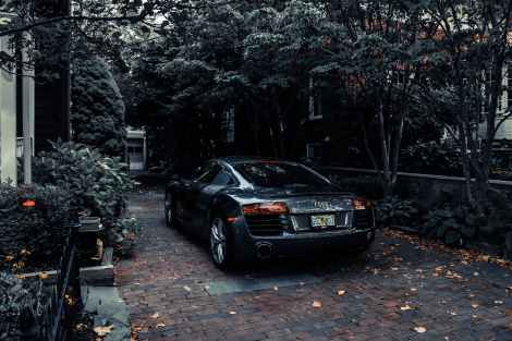 photo of audi parked near trees, abundance mindset