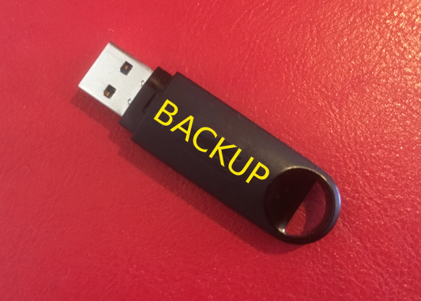 USB Stick with the label BACKUP