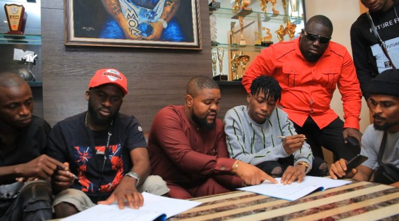 Davido officially signs Lil Frosh to DMW record