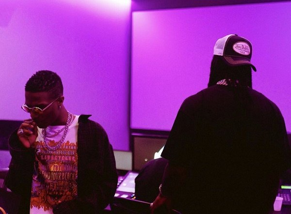 Fans Excited As Wizkid Hints Collaboration With Burna Boy (Photos)