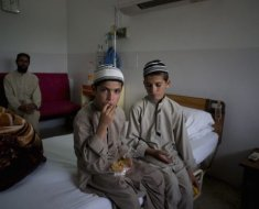 Abdul Rasheed, 9, left, and Shoaib Ahmed, 13 are active during day but get paralyzed at night.
