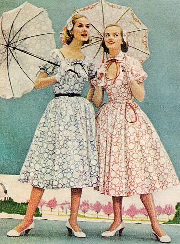 1950's fashion full skirted dress and parasols