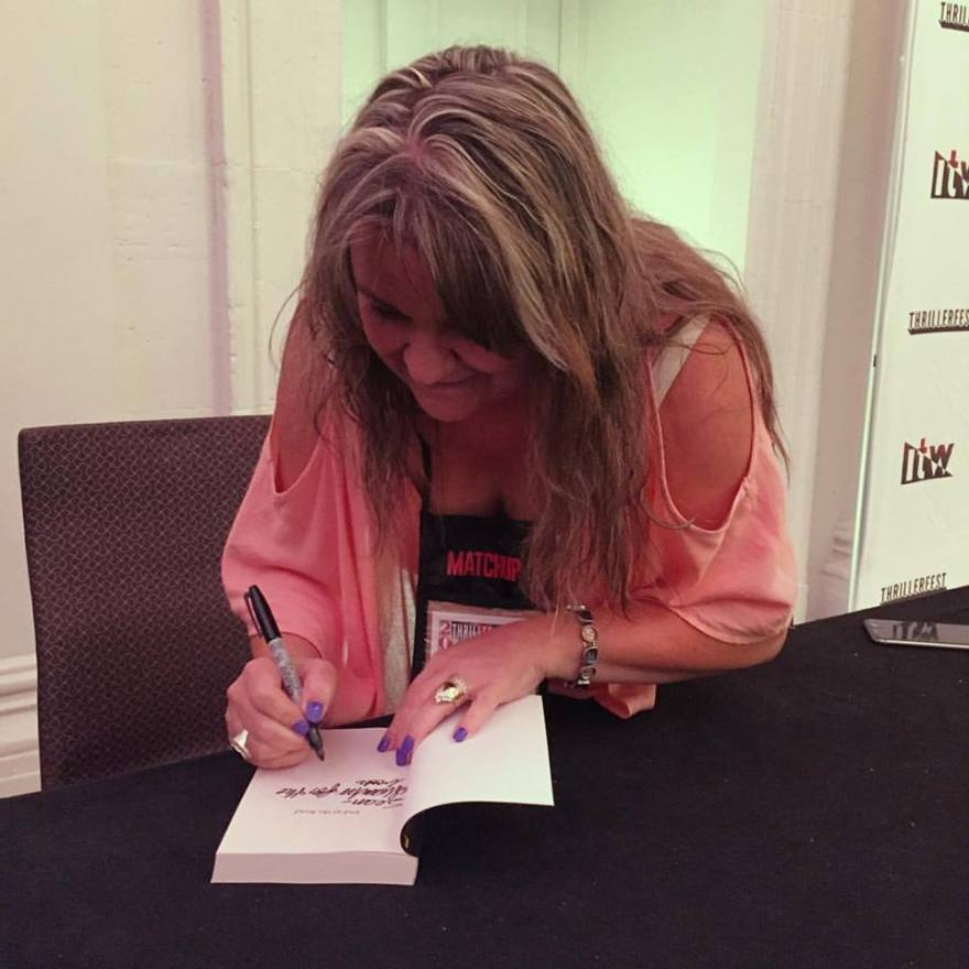 me signing books