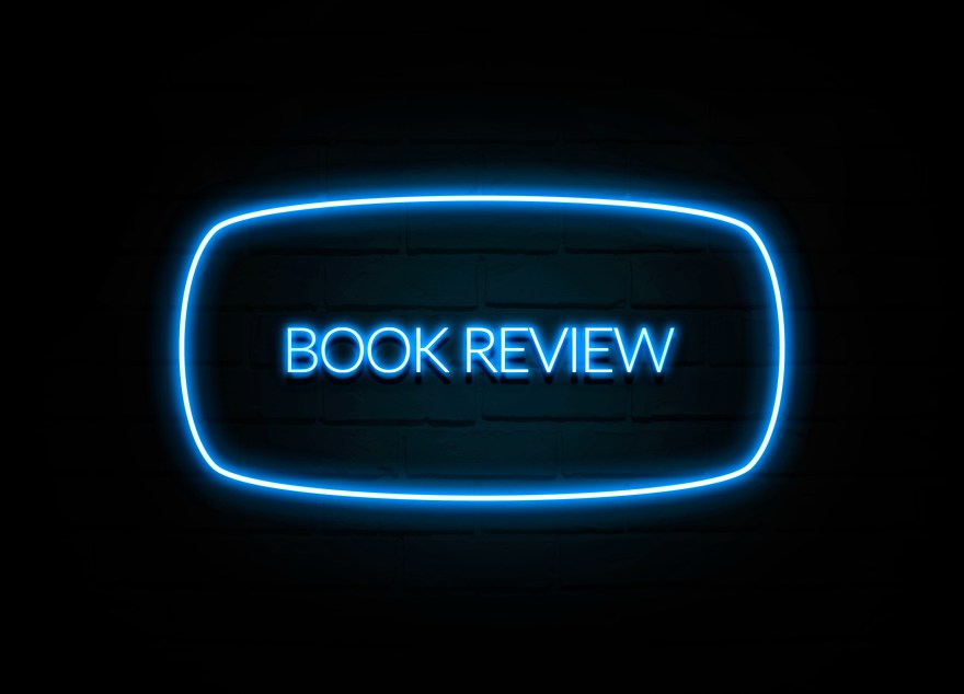 Book Review  - colorful Neon Sign on brickwall