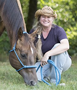 Elena Hartwell author photo with horse