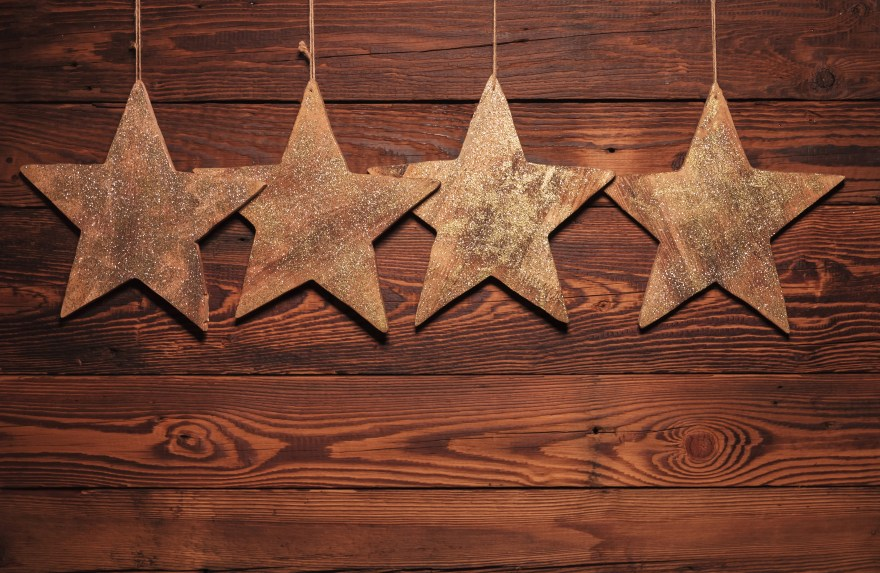 four wooden stars for christmas