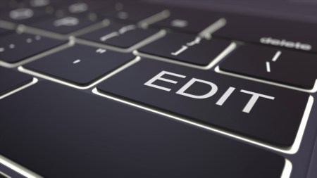 Black luminous computer keyboard and edit key. Conceptual 3D rendering