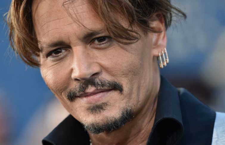 Johnny Depp Settles For $350,000 With Ex-Lawyers In Court Battle