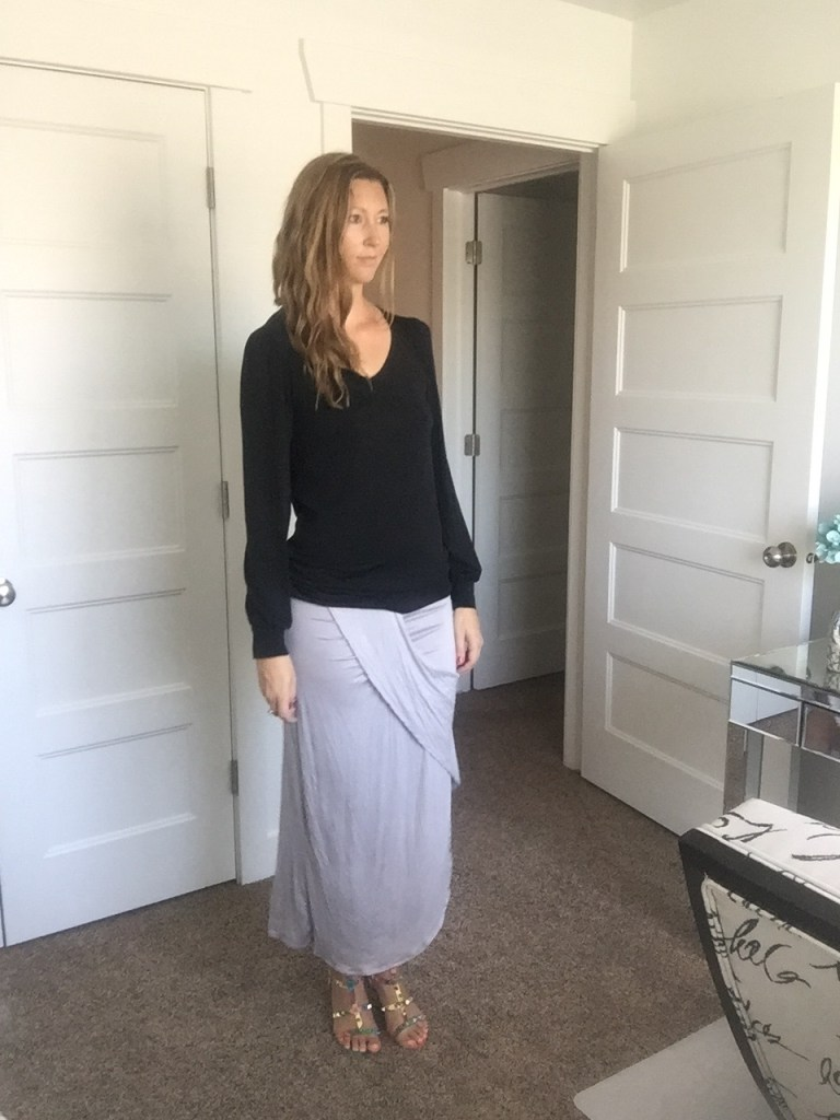 black blouse and gray wrap skirt