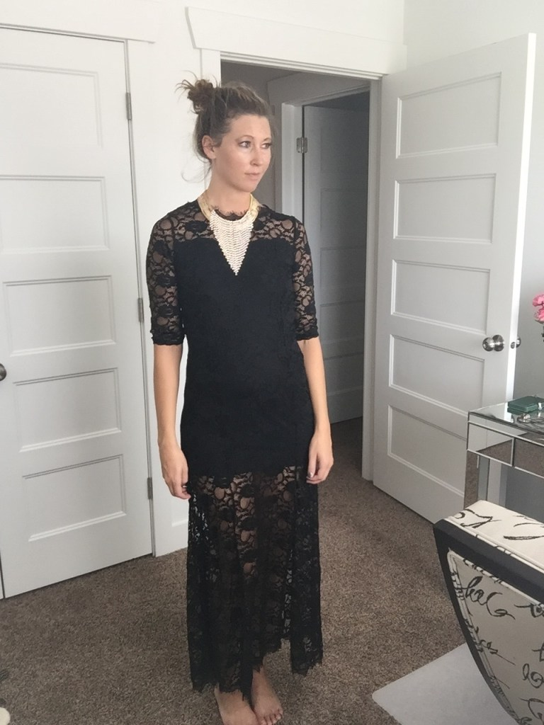 Black lace dress with elegant gold layered necklace