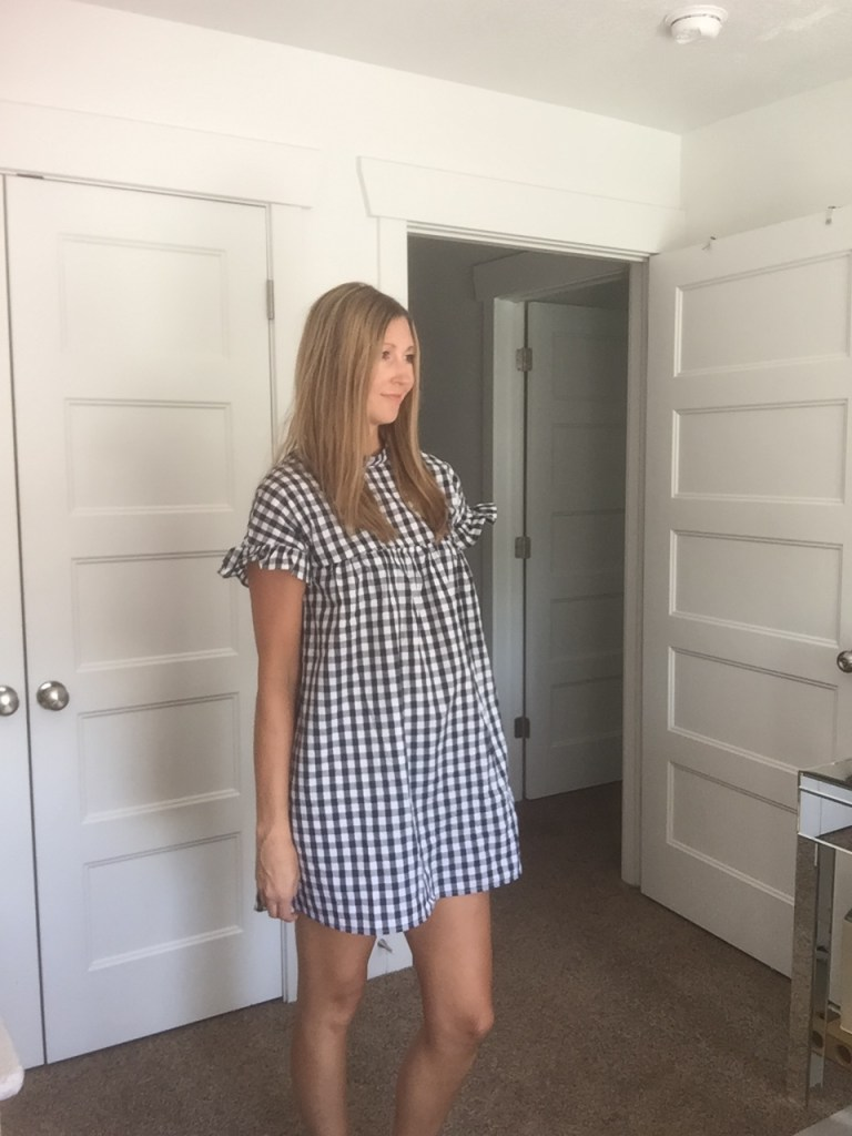 Woman in Gingham Black and White Babydoll Dress
