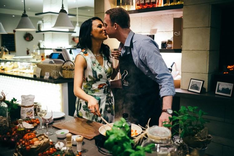 engagement session - cooking class - couple kissing - bride - groom - bride-to-be - engaged - engagement - engagement photos - creative engagement photos - engagement photos ideas - romantic dinner - italian food - pulia london