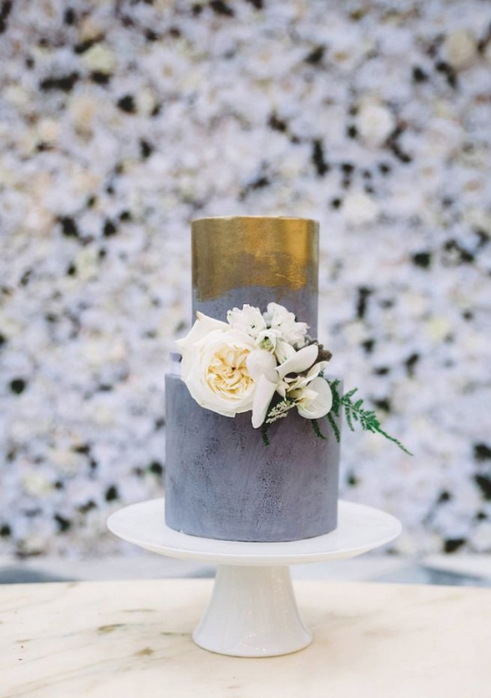 Metalic gold and grey wedding cake with white flowers | See more: http://mysweetengagement.com/15-extraordinary-wedding-cakes-for-all-wedding-styles
