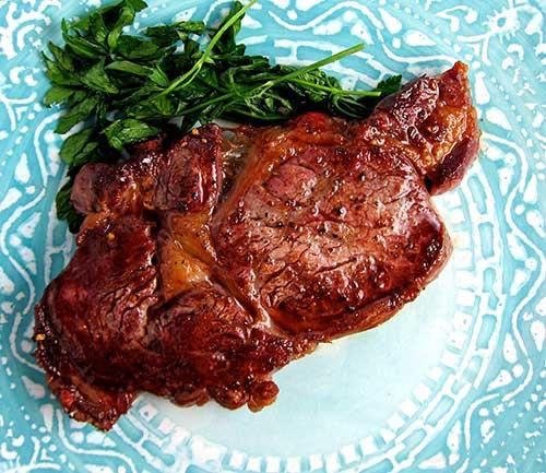 Seared steak in a cast iron pan.