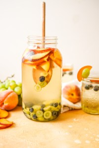 White wine and elderflower sangria with peaches, green grapes and blueberries | refreshing sangria | summer cocktails |summer recipes | patio drinks | sangria | white wine