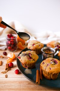 cranberry orange muffins with a orange cinnamon glaze, the perfect snack for any family member | A hint of orange, and tart cranberries are the perfect match for these muffins | weekend baking | muffins | healthyish | recipes to make with kids