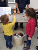 Visitors test various ways to clean up an oil spill