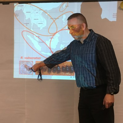 Dr. Hoddle points out locations of an invasive insect