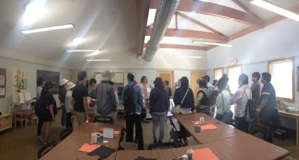 Students hear a talk inside the nature center by Teresa Woodard, Education Curator of the Riverside Metropolitan Museum